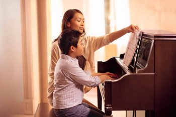 HOW PLAYING THE PIANO CAN HELP YOUR CHILD'S DEVELOPMENT